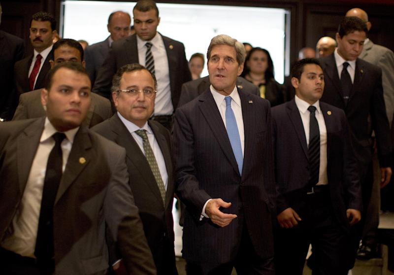 U.S. Secretary of State John Kerry, center, walks with Egypt's Foreign Minister Nabil Fahmy, second left, to their joint press conference in Cairo, Sunday, Nov. 3, 2013. Kerry is in Cairo pressing for reforms during the highest-level American visit to Egypt since the ouster of the country's first democratically elected president. The Egyptian military's removal of Mohammed Morsi in July led the U.S. to suspend hundreds of millions of dollars in aid. This is the first stop in an 11-day trip that will take Kerry to the Mideast and Europe. (AP Photo/Jason Reed, Pool)