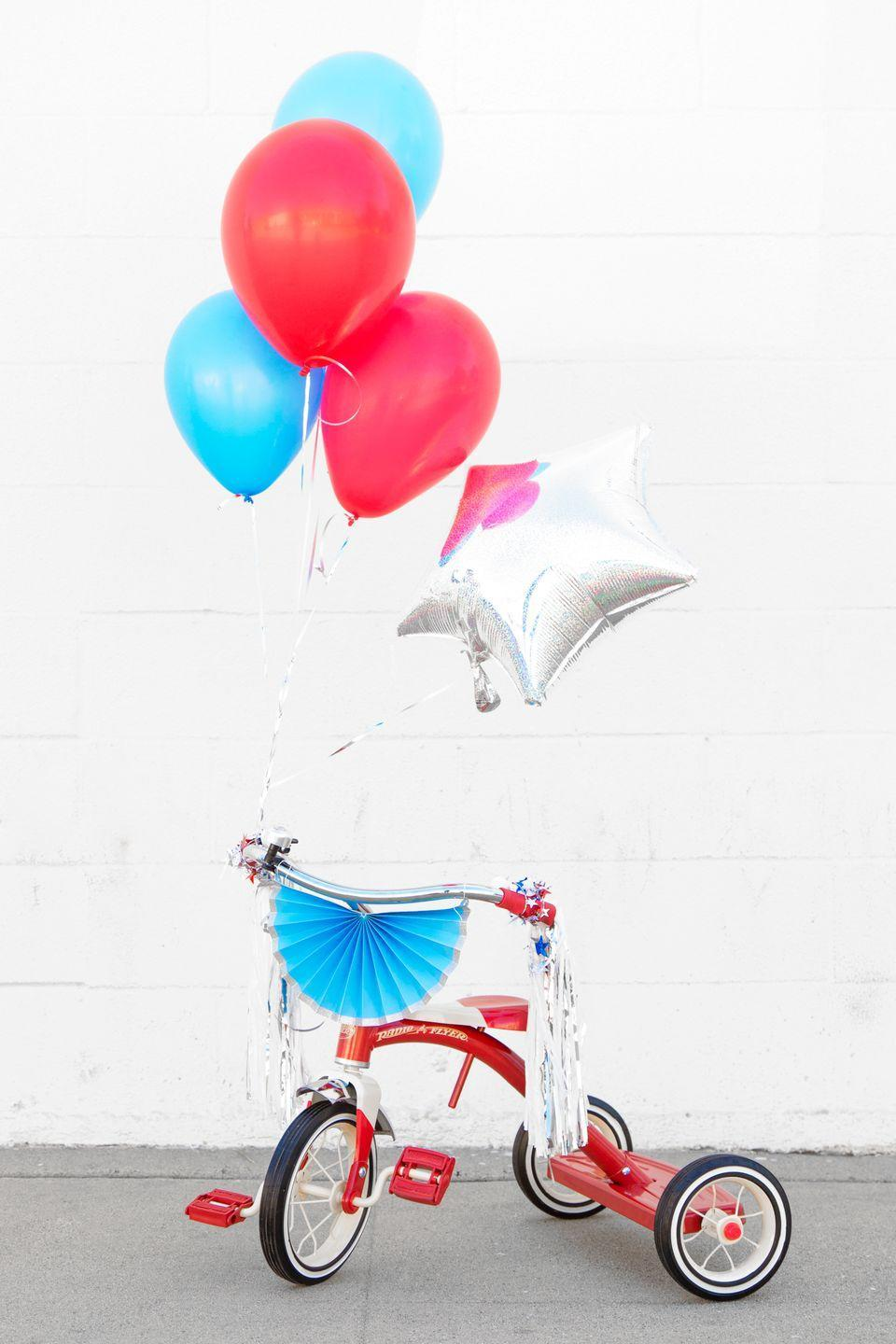 """<p>Hosting a block party? Have all of the kids decorate their bikes, then have a neighborhood bike parade. Hand out prizes for the most festive execution. </p><p><a class=""""link rapid-noclick-resp"""" href=""""https://studiodiy.com/diy-fourth-july-balloon-bikes/"""" rel=""""nofollow noopener"""" target=""""_blank"""" data-ylk=""""slk:GET THE TUTORIAL"""">GET THE TUTORIAL</a></p><p><a class=""""link rapid-noclick-resp"""" href=""""https://www.amazon.com/White-Patriotic-Crepe-Paper-Streamers/dp/B00BFX7AEU?tag=syn-yahoo-20&ascsubtag=%5Bartid%7C10072.g.32715018%5Bsrc%7Cyahoo-us"""" rel=""""nofollow noopener"""" target=""""_blank"""" data-ylk=""""slk:SHOP STREAMERS"""">SHOP STREAMERS</a></p>"""