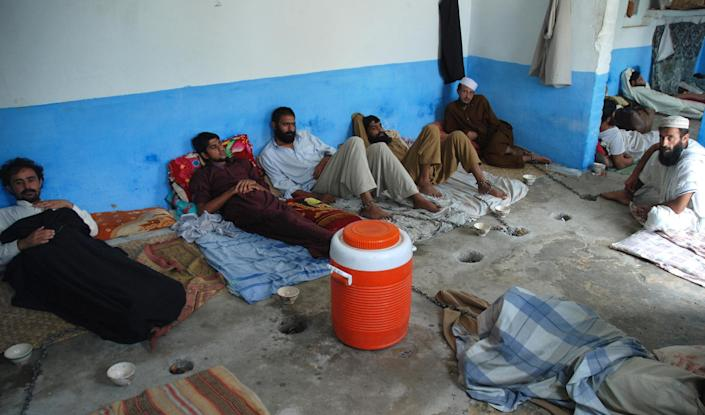 Drug addicts at a centre run by local cleric Mullah Ilyas Qadri in Haripur on on July 19, 2014 (AFP Photo/Shakil Ahmad)