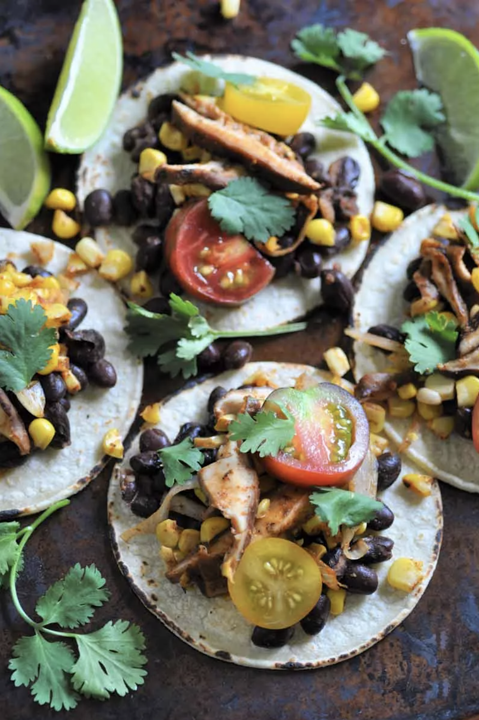 """<p>Highly recommend making these in the summer when you can top 'em with perfectly ripe and juicy cherry tomatoes.</p> <p>Get the recipe <a href=""""https://www.veganosity.com/spicy-black-bean-shitake-mushroom-street-tacos/"""" rel=""""nofollow noopener"""" target=""""_blank"""" data-ylk=""""slk:here"""" class=""""link rapid-noclick-resp"""">here</a>.</p> <p><strong>Related:</strong></p> <ul> <li><a href=""""https://www.self.com/gallery/healthy-summer-recipes?mbid=synd_yahoo_rss"""" rel=""""nofollow noopener"""" target=""""_blank"""" data-ylk=""""slk:40 Healthy Summer Recipes You'll Want to Make All Season Long"""" class=""""link rapid-noclick-resp"""">40 Healthy Summer Recipes You'll Want to Make All Season Long</a></li> <li><a href=""""https://www.self.com/gallery/healthy-smoothie-recipes?mbid=synd_yahoo_rss"""" rel=""""nofollow noopener"""" target=""""_blank"""" data-ylk=""""slk:31 Healthy Smoothie Recipes That Are Fast and Filling"""" class=""""link rapid-noclick-resp"""">31 Healthy Smoothie Recipes That Are Fast and Filling</a></li> <li><a href=""""https://www.self.com/gallery/meatless-instant-pot-dinners?mbid=synd_yahoo_rss"""" rel=""""nofollow noopener"""" target=""""_blank"""" data-ylk=""""slk:25 Healthy Vegetarian Instant Pot Recipes"""" class=""""link rapid-noclick-resp"""">25 Healthy Vegetarian Instant Pot Recipes</a></li> </ul>"""