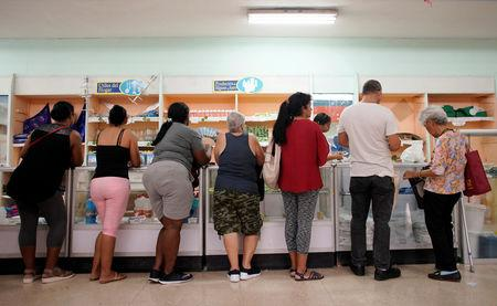 People wait in line to buy goods in a state store in downtown Havana, Cuba, May 10, 2019. REUTERS/Alexandre Meneghini