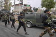 Indian army soldiers walks back towards their vehicle after a gun battle on the outskirts of Srinagar, Indian controlled Kashmir, Sunday, Nov. 1, 2020. According to police, Indian government forces killed Saifullah Mir, a top rebel commander of the region's largest rebel group, Hizbul Mujahideen which has spearheaded an armed rebellion against Indian rule for decades. (AP Photo/ Dar Yasin)