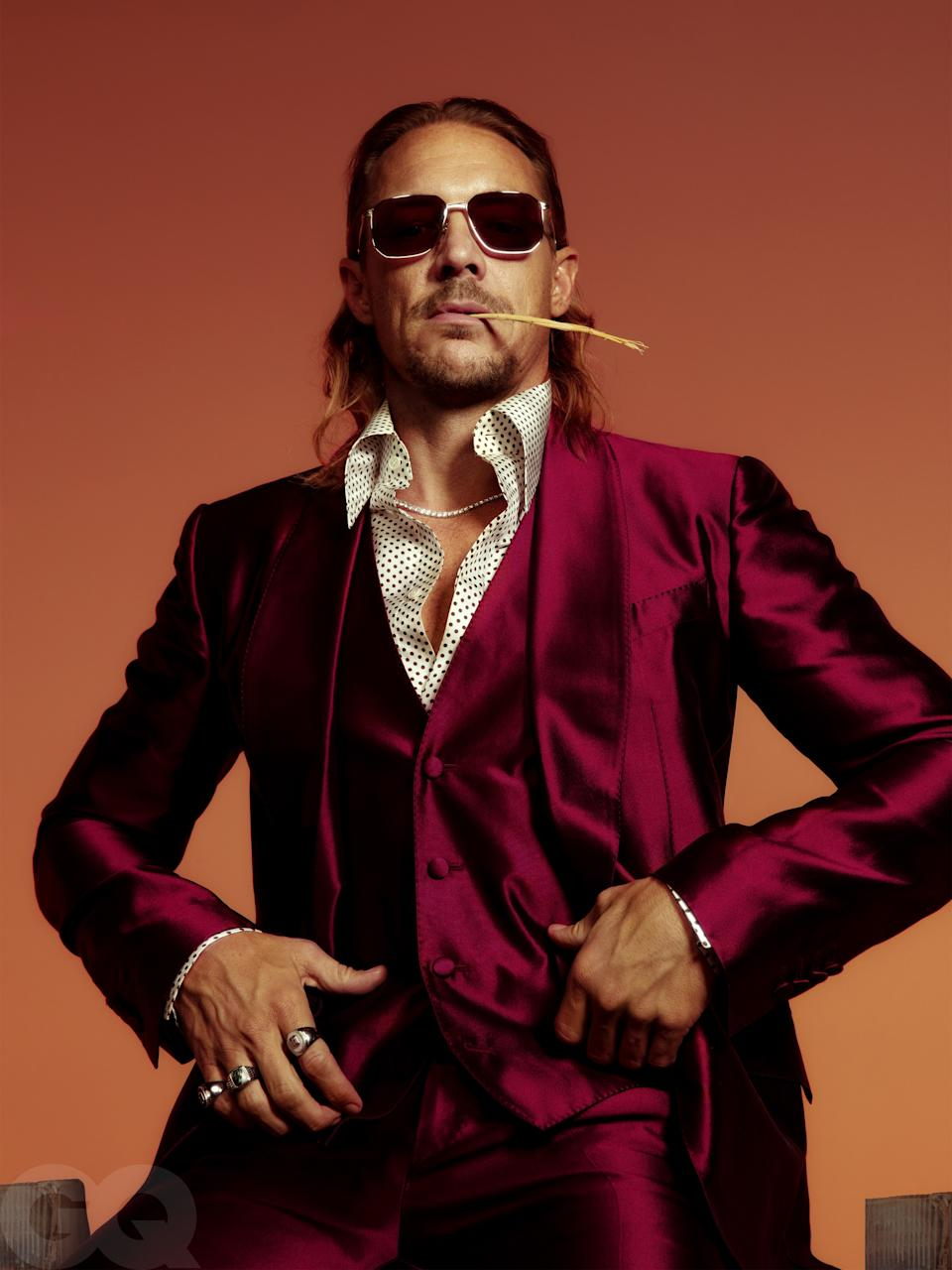 """<cite class=""""credit"""">Suit, $4,395, and shirt, $1,195, by Dolce & Gabbana / Sunglasses, $310, by Persol / Necklace, $67,200, by Shay / Rings, $590 (on pinkie), and $780 (on index finger), by Othongthai / Ring, $229 (on ring finger), by LMJ</cite>"""