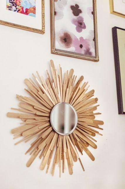 "<p>Create a beautiful piece of snowflake-inspired wall decor — or the perfect homemade Christmas present — using popsicle sticks. Find a small mirror at the dollar store, and surround with layers of popsicle sticks.</p><p><em><a href=""https://gracefullysearching.blogspot.com/2012/11/sunburst-mirror.html"" rel=""nofollow noopener"" target=""_blank"" data-ylk=""slk:Get the tutorial at Gracefully Searching»"" class=""link rapid-noclick-resp"">Get the tutorial at Gracefully Searching»</a></em></p>"