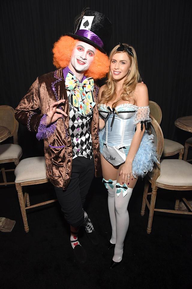 <p>The Olympic swimmer got all decked out as the Mad Hatter, while his fiancée, Kayla Rae Reid, naturally went as a sexy Alice in Wonderland. How original! (Photo: Michael Kovac/Getty Images) Tequila) </p>