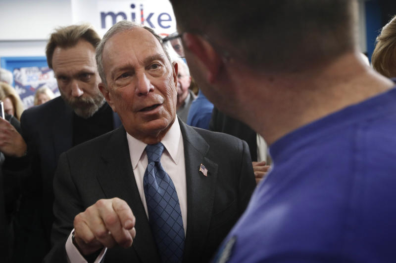 FILE - In this Monday, Jan. 27, 2020, file photo, Democratic presidential candidate and former New York City mayor Mike Bloomberg speaks to a voter in Scarborough, Maine. Bloomberg has been the only major candidate to campaign in Maine in recent weeks. Maine holds it's primary on Super Tuesday, March 3rd. (AP Photo/Robert F. Bukaty, File)