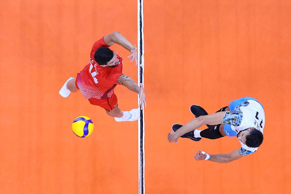<p>TOKYO, JAPAN - JULY 28: Sebastian Sole #11 of Team Argentina hits past Nicolas le Goff #14 of Team France during the Men's Preliminary Round - Pool B volleyball on day five of the Tokyo 2020 Olympic Games at Ariake Arena on July 28, 2021 in Tokyo, Japan. (Photo by Toru Hanai/Getty Images)</p>