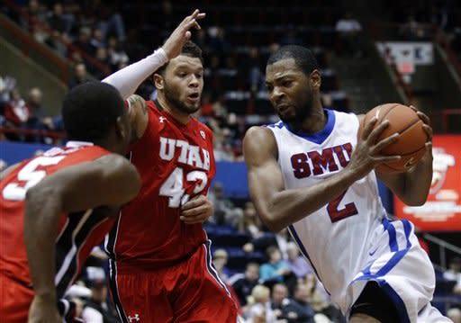 Utah's Jarred DuBois (5) and Cedric Martin (43) defend against a drive to the basket by SMU's Shawn Williams (2) in the first half of an NCAA college basketball game on Wednesday, Nov. 28, 2012, in Dallas. (AP Photo/Tony Gutierrez)