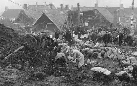 Rescue workers at the scene of the wrecked Pantglas Junior School at Aberfan - Credit: Keystone/Hulton Archive/Getty Images