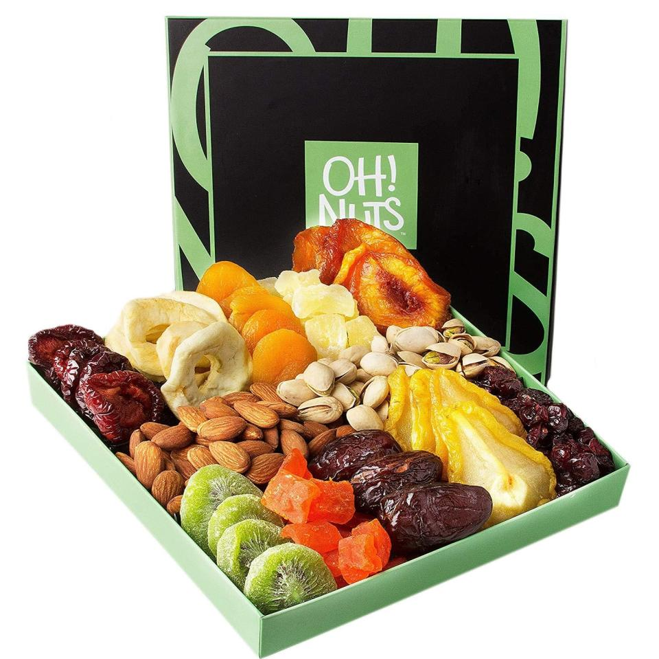 <p>The more health-conscious household will love this <span>Holiday Nut and Dried Fruit Gift Basket</span> ($29).</p>