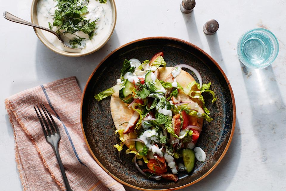 """In these satisfying sandwiches, the cool, crunchy cucumbers, dressed in lemon and tossed with tomato and onion, balance the warmth of spice-roasted chicken. <a href=""""https://www.epicurious.com/recipes/food/views/shawarma-spiced-chicken-pita-with-tahini-yogurt-sauce?mbid=synd_yahoo_rss"""" rel=""""nofollow noopener"""" target=""""_blank"""" data-ylk=""""slk:See recipe."""" class=""""link rapid-noclick-resp"""">See recipe.</a>"""