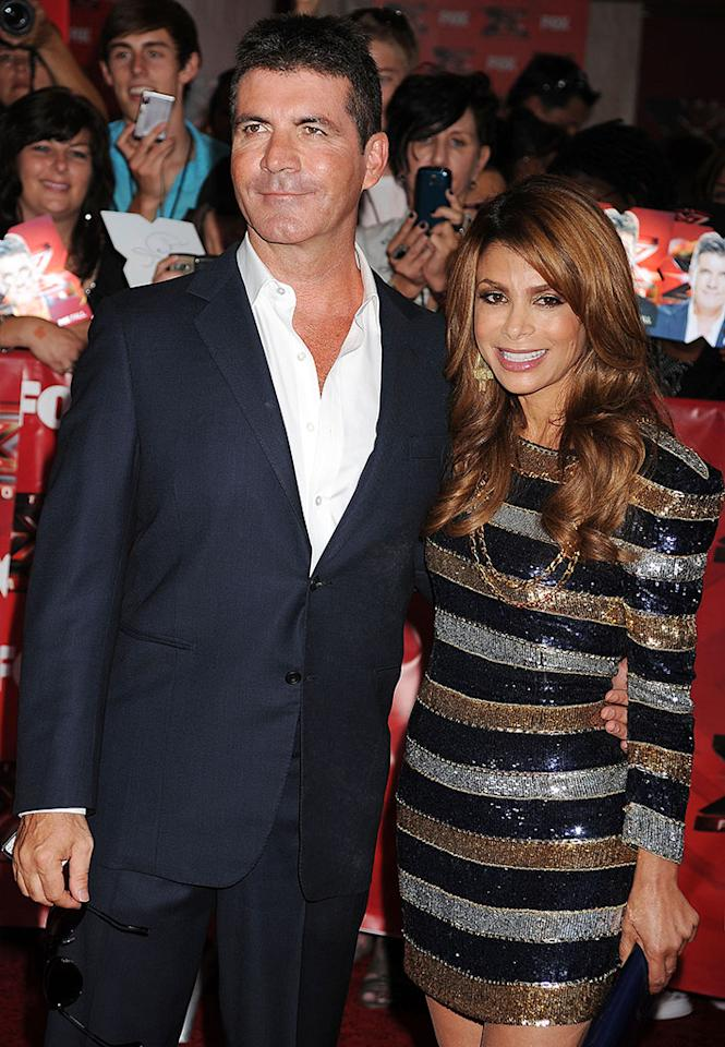 "HOLLYWOOD, CA - SEPTEMBER 14: Simon Cowell and Paula Abdul attend ""The X Factor"" World Premiere Screening at ArcLight Cinemas on September 14, 2011 in Hollywood, California. (Photo by Jeffrey Mayer/WireImage)"