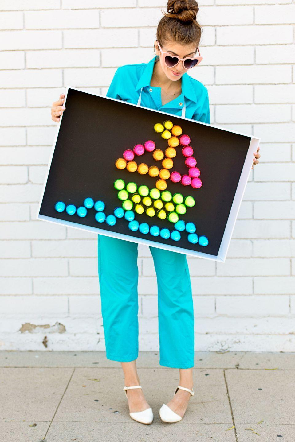"""<p>Shine bright this Halloween when you pay tribute to one of the all-time greatest '80s toys. This clever tutorial teaches you how to make a Lite-Brite costume out of neon plastic shot glasses and one secret household ingredient. </p><p><strong>See more at <a href=""""https://studiodiy.com/diy-lite-brite-costume/"""" rel=""""nofollow noopener"""" target=""""_blank"""" data-ylk=""""slk:Studio DIY!"""" class=""""link rapid-noclick-resp"""">Studio DIY!</a>.</strong></p><p><strong><a class=""""link rapid-noclick-resp"""" href=""""https://go.redirectingat.com?id=74968X1596630&url=https%3A%2F%2Fwww.walmart.com%2Fip%2F1-Party-Essentials-2-Oz-Plastic-Shot-Glasses-Assorted-Neons-Box-Set-60-ct%2F25574913&sref=https%3A%2F%2Fwww.thepioneerwoman.com%2Fholidays-celebrations%2Fg32645069%2F80s-halloween-costumes%2F"""" rel=""""nofollow noopener"""" target=""""_blank"""" data-ylk=""""slk:SHOP SHOT GLASSES"""">SHOP SHOT GLASSES</a></strong> </p>"""