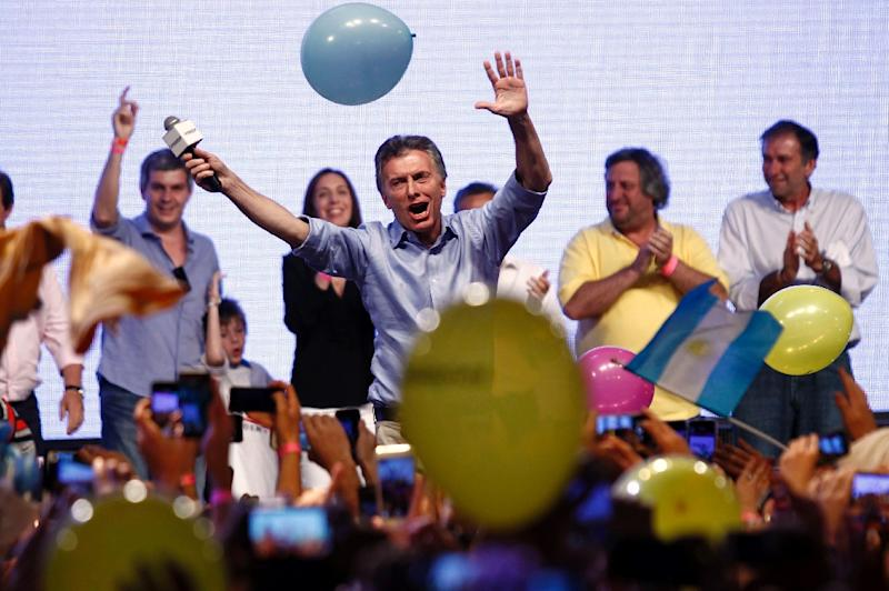 Mauricio Macri (centre) celebrates his victory in the presidential run-off election at the Cambiemos (Let's Change) party headquarters in Buenos Aires, on November 22, 2015 (AFP Photo/Emiliano Lasalvia)