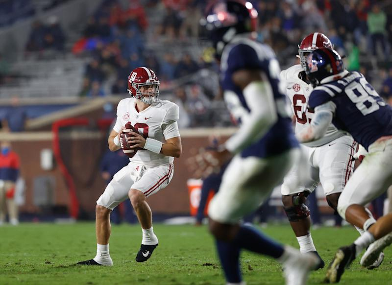 Alabama QB Mac Jones, left, had another strong game against Ole Miss. (Photo by Kent Gidley/Collegiate Images/Getty Images)