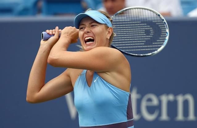 Maria Sharapova of Russia hits a return to Madison Keys of the US during the Western & Southern Open, at the Lender Family Tennis Center in Cincinnati, Ohio, on August 12, 2014 (AFP Photo/Andy Lyons)