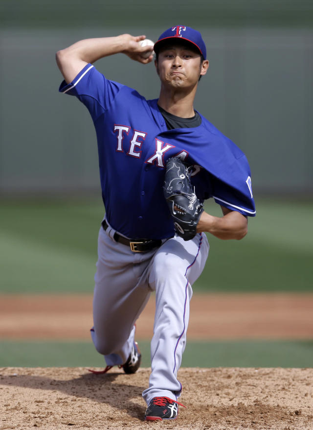 Texas Rangers' Yu Darvish (11), of Japan, delivers to the Kansas City Royals in the second inning of an exhibition baseball game on Thursday Feb. 27, 2014, in Surprise, Ariz. (AP Photo/Tony Gutierrez)