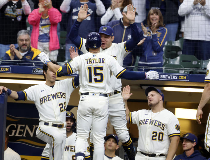 Milwaukee Brewers' Tyrone Taylor (15) is congratulated after his home run against the St. Louis Cardinals during the fourth inning of a baseball game Thursday, Sept. 23, 2021, in Milwaukee. It was Taylor's second home run of the game. (AP Photo/Jeffrey Phelps)