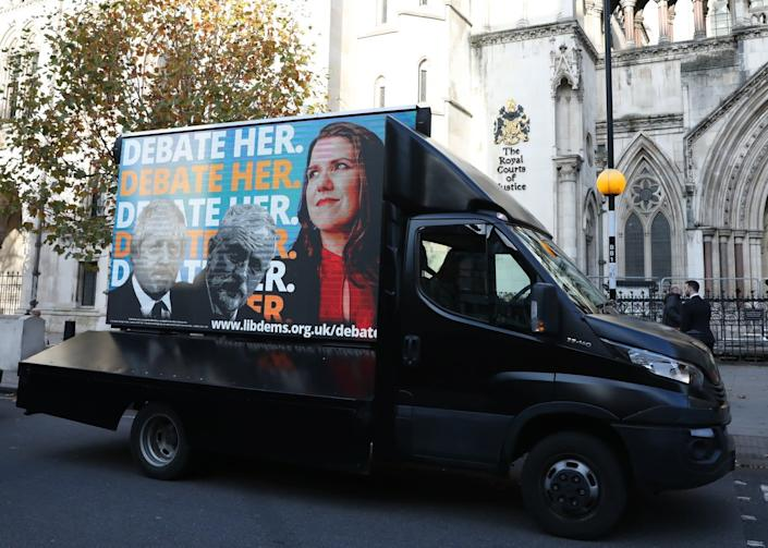 An advertising van showing Boris Johnson, Jeremy Corbyn and Jo Swinson outside the Royal Courts of Justice: PA