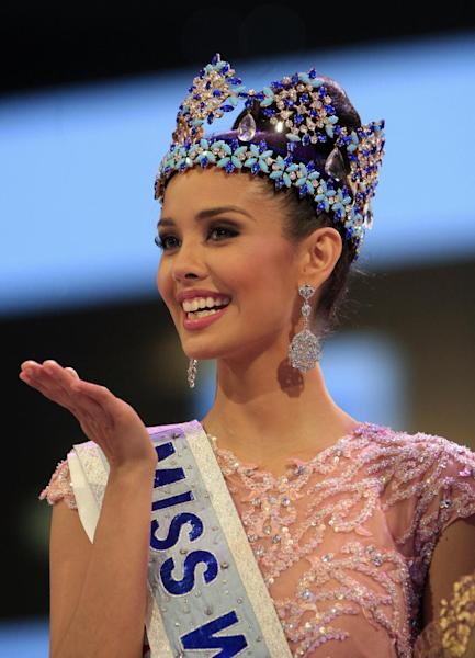 Newly crowned Miss World Megan Young of the Philippines, smiles after winning the Miss World contest, in Nusa Dua, Bali, Indonesia, Saturday, Sept. 28, 2013. (AP Photo/Firdia Lisnawati)
