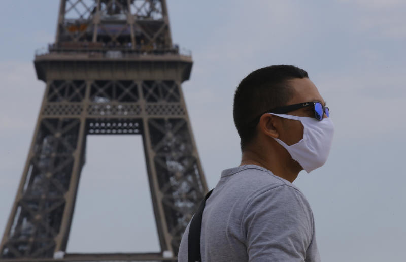 A man wearing a mask to prevent the spread of COVID-19 walks at Trocadero plaza near Eiffel Tower in Paris, Saturday, Aug 8, 2020. The French health agency said yesterday indicators show an increasingly active circulation of the virus, ''especially among young adults,'' and appealed for respect of safety measures ''and good sense.''(AP Photo/Michel Euler)