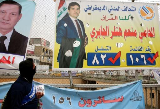 An electoral campaign poster of Democratic Civil Alliance candidate Momeim Hitler al-Jabri hangs in central Baghdad on May 8, 2018