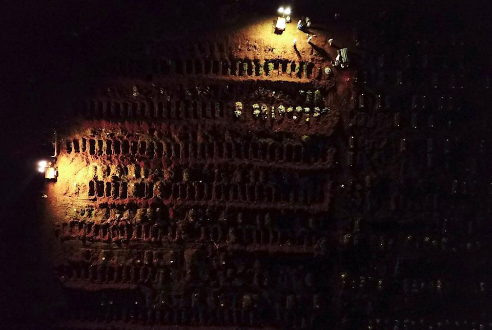 Drone footage shows spotlights illuminating the graves during night burials amid the coronavirus disease (COVID-19) at Vila Formosa cemetery in Sao Paulo, Brazil, March 30, 2021. Picture taken March 30, 2021. Picture taken with a drone. REUTERS/Amanda Perobelli