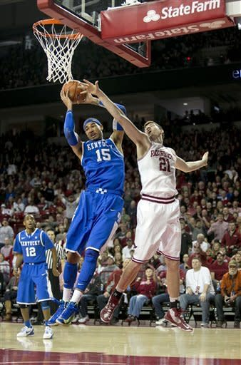 Kentucky's Willie Cauley-Stein (15) fights for the ball under the basket against Arkansas' Hunter Mickelson (21) during the first half of an NCAA college basketball game in Fayetteville, Ark., Saturday, March 2, 2013. (AP Photo/Gareth Patterson)