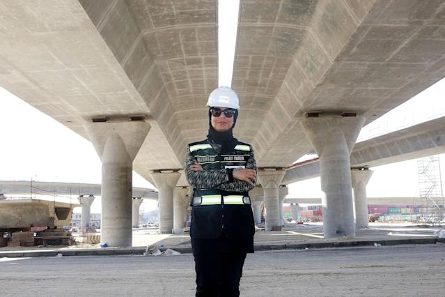<p>Mai Ibrahim Al-Mesad, project manager of the maritime section of the Jaber Al-Ahmad Causeway, at the construction site in Kuwait City on March 4, 2018. The Jaber Al-Ahmad Causeway is considered one of the longest in the world, covering a distance of 37 kilometers between Kuwait City and Subbiy. (Photo: Yasser al-Zayyat/AFP/Getty Images) </p>