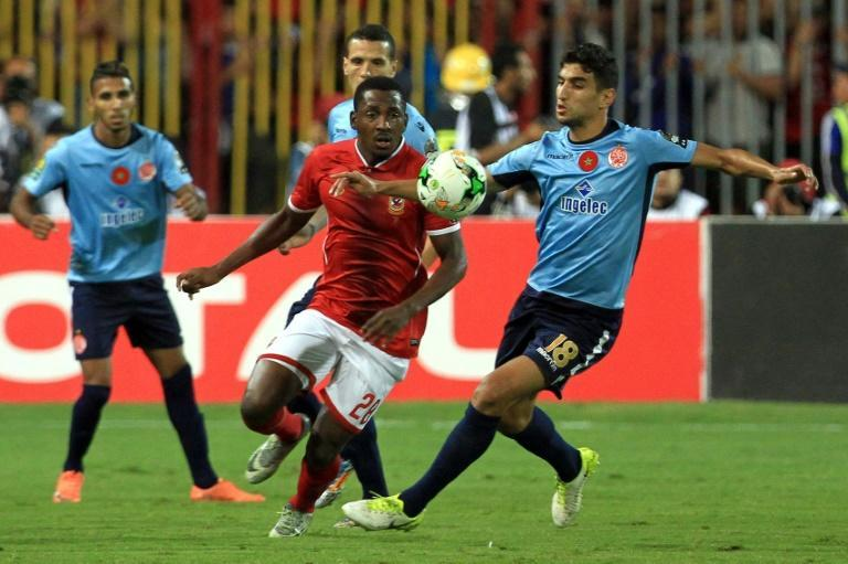 Junior Ajayi (C) is a Nigerian forward who plays for African champions Al Ahly of Egypt.