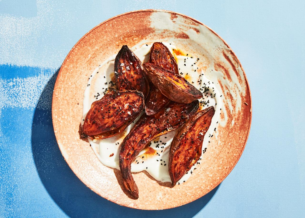 "This recipe is nice twice. The roasting and honey-glazing method is a great way to make sweet potatoes, and you also get an eggless garlic sauce that you'll use again and again. <a href=""https://www.bonappetit.com/recipe/charred-sweet-potatoes-with-toum?mbid=synd_yahoo_rss"">See recipe.</a>"