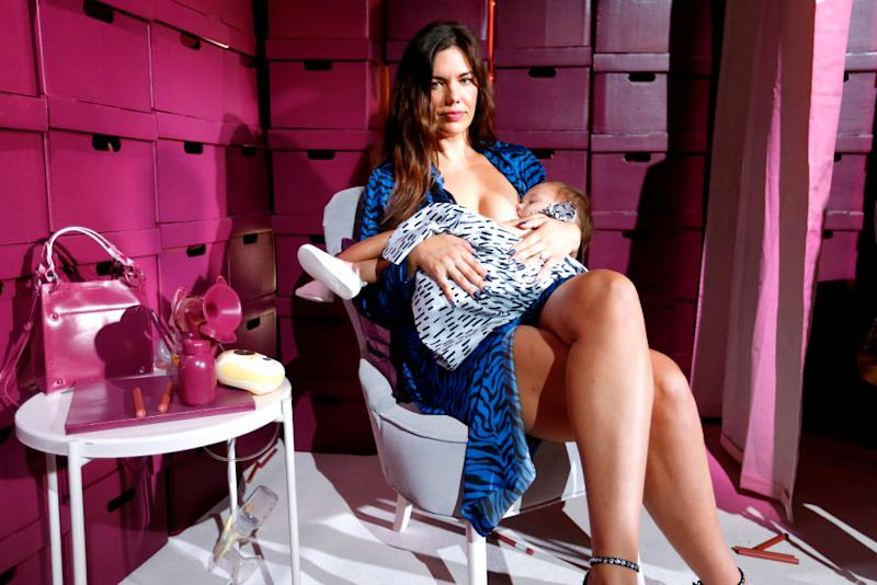 Model Mara Martin appeared breastfeeding her daughter during the Rebecca Minkoff NYFW show on Saturday [Photo: Getty]