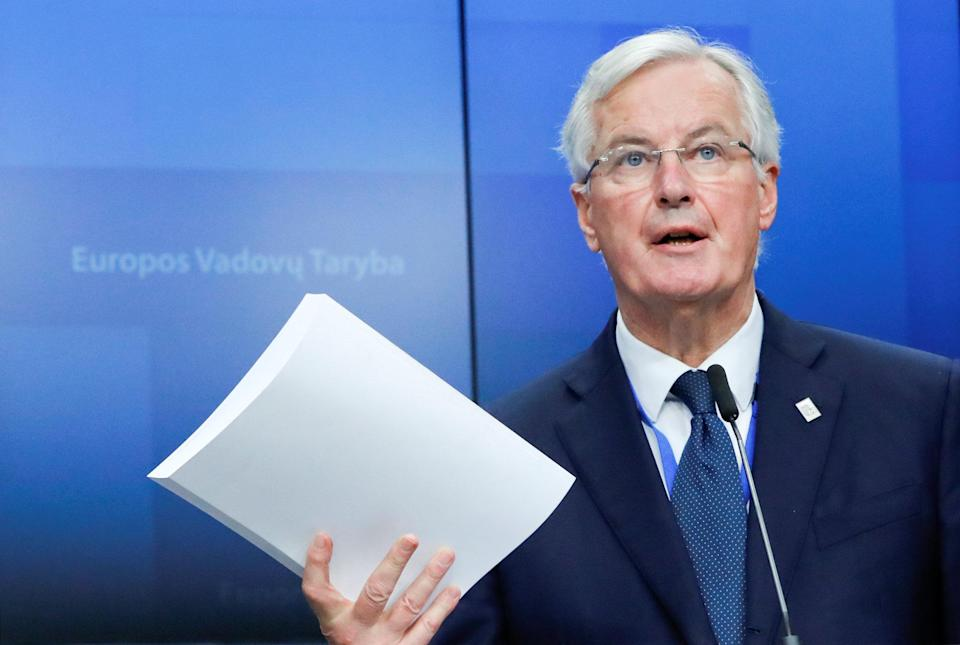 EU chief negotiator Michel Barnier holding a copy of the 585 page withdrawal agreement (Reuters)