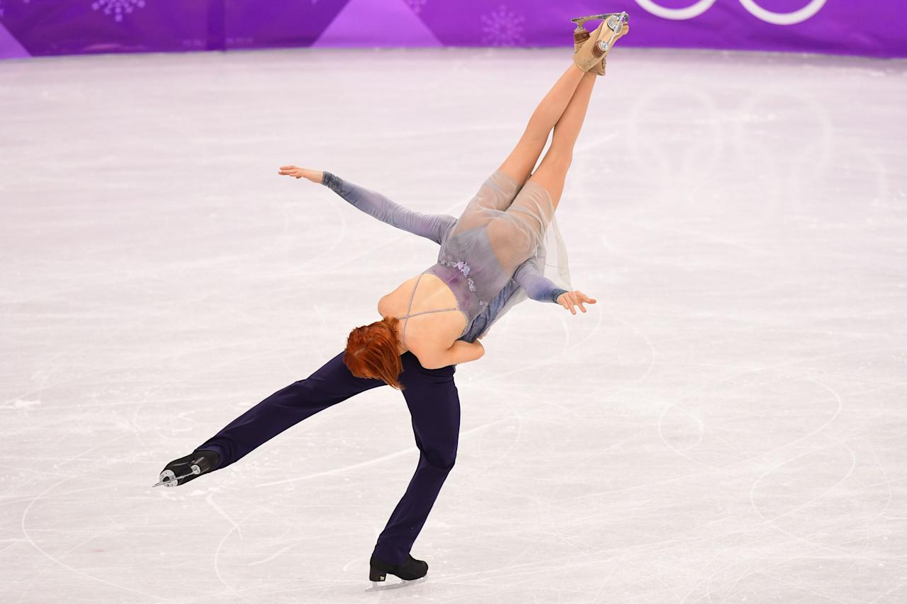 <p>Russia's Tiffani Zagorski and Russia's Jonathan Guerreiro compete in the ice dance free dance of the figure skating event during the Pyeongchang 2018 Winter Olympic Games at the Gangneung Ice Arena in Gangneung on February 20, 2018. / AFP PHOTO / Roberto SCHMIDT </p>