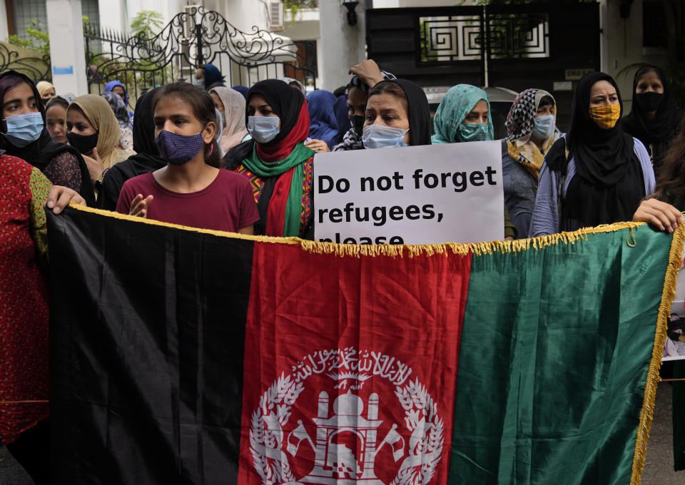 Afghans living in Delhi participate in a protest outside the UNHCR office (United Nation High Commissioner for Refugees) in New Delhi, India, Monday, Aug. 23, 2021. Hundreds of Afghans living in India gathered to protest against the Taliban takeover of Afghanistan and also demanded to be given refugee status in India. (AP Photo/Manish Swarup)