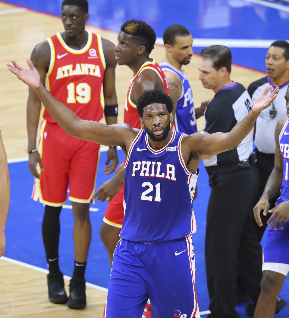 Philadelphia 76ers center Joel Embiid fires up the fans after going face to face with Atlanta Hawks center Clint Capela in Game 5 of an NBA basketball Eastern Conference semifinal Wednesday, June 16, 2021, in Philadelphia. (Curtis Compton/Atlanta Journal-Constitution via AP)
