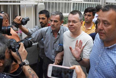 FILE PHOTO: U.S. pastor Andrew Brunson reacts as he arrives at his home after being released from the prison in Izmir
