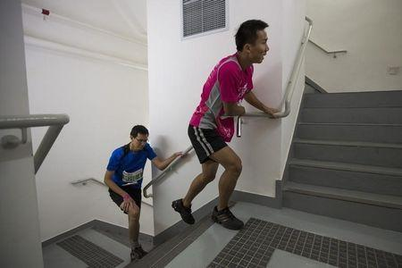 Competitors climb stairs during the SHKP Vertical Run for the Chest race in Hong Kong