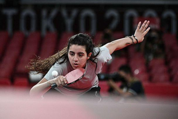PHOTO: Syria's Hend Zaza hits a shot against Austria's Liu Jia during their women's singles preliminary round table tennis match at the Tokyo Metropolitan Gymnasium during the Tokyo 2020 Olympic Games in Tokyo on July 24, 2021. (Anne-christine Poujoulat/AFP via Getty Images)