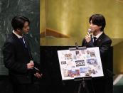 ADDS IDS - Members of South Korean K-pop band BTS Jung Kook, left, and Jimin appear at the United Nations meeting on Sustainable Development Goals during the 76th session of the U.N. General Assembly at U.N. headquarters on Monday, Sept. 20, 2021. (John Angelillo/Pool Photo via AP)
