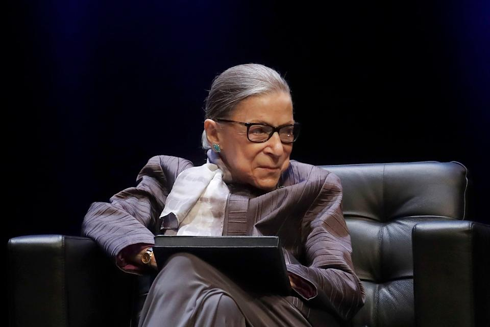 In this Oct. 21, 2019, file photo Supreme Court Justice Ruth Bader Ginsburg listens to speakers during the inaugural Herma Hill Kay Memorial Lecture at the University of California at Berkeley in Berkeley, Calif.