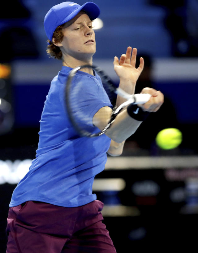 Jannik Sinner of Italy returns the ball to Alex De Minaur of Australia, during the ATP Next Gen tennis tournament final match, in Milan, Italy, Saturday, Nov. 9, 2019. (AP Photo/Luca Bruno)