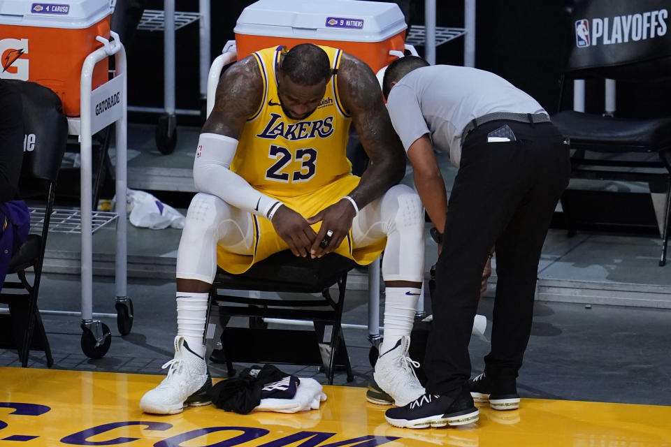 Los Angeles Lakers forward LeBron James (23) sit on the bench during the fourth quarter of Game 6 of an NBA basketball first-round playoff series against the Phoenix Suns Thursday, June 3, 2021, in Los Angeles. The Suns won the game 113-100, and the series 4-2. They will move on to round 2. (AP Photo/Ashley Landis)