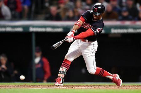 Cleveland Indians shortstop Francisco Lindor (12) hits an RBI fielder's choice during the fifth inning against the Chicago White Sox at Progressive Field, Cleveland, OH, USA, September 30, 2017. Mandatory Credit: Ken Blaze-USA TODAY Sports