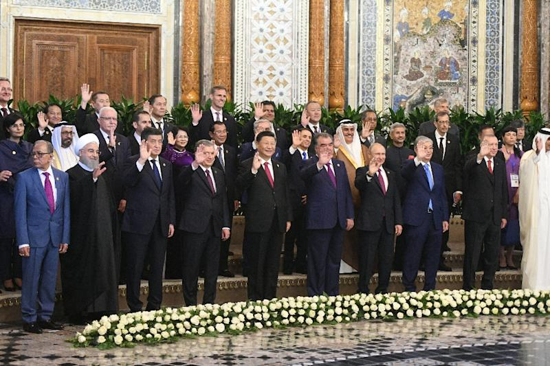 Putin and Xi posed with other world leaders for a family photo at a summit in Tajikistan (AFP Photo/Alexei Druzhinin)