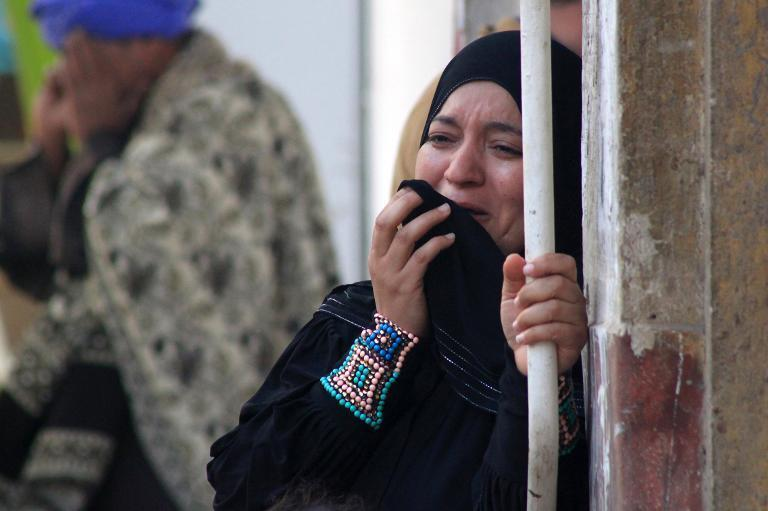 A relative of a supporter of Mohamed Morsi cries outside the courthouse on March 24, 2014 in the central Egyptian city of Minya, after the court ordered the execution of 529 Morsi supporters