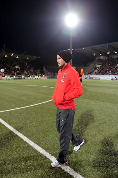 English midfielder David Beckham of Paris Saint Germain walks on the field during the French League One soccer match against Lorient, Sunday, May 26, 2013 in Lorient, western France. Beckham play officially his last game tonight as a professional player. (AP Photo/David Vincent)