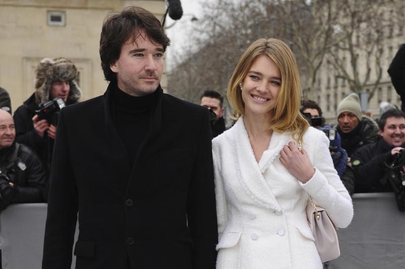 "FILE - In this Friday, March 1, 2013 file photo Antoine Arnault and Natalia Vodianova arrive for Dior's Ready to Wear's Fall-Winter 2013-2014 fashion collection presented in Paris. As the France woke up in collective sadness at the fire damage to Notre Dame cathedral, its richest businessman, Bernard Arnault, the father of Antoine, and his luxury goods group LVMH answered that call with a pledge of 200 million euros ($226 million). A communique said that the Arnault family was ""in solidarity with this national tragedy, and join in the reconstruction of this extraordinary cathedral, a symbol of France, of its heritage and togetherness."" (AP Photo/Zacharie Scheurer, File)"