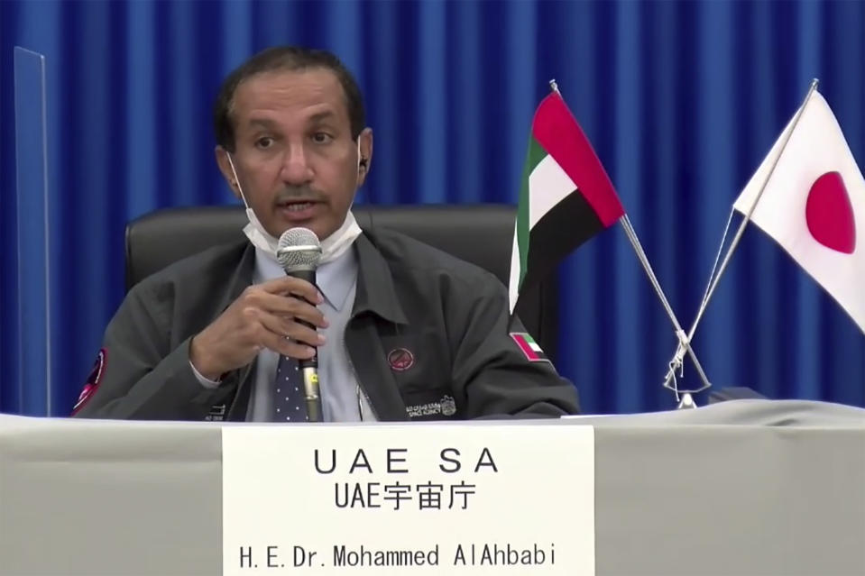 In this image made from a video, Mohammed AlAhbabi of UAE Space Agency attends a news conference at Tanegashima Space Center on a small southern Japanese island after a launch of a United Arab Emirates spacecraft Monday, July 20, 2020. A United Arab Emirates spacecraft rocketed away Monday on a seven-month journey to Mars, kicking off the Arab world's first interplanetary mission. (MHI via AP Photo)