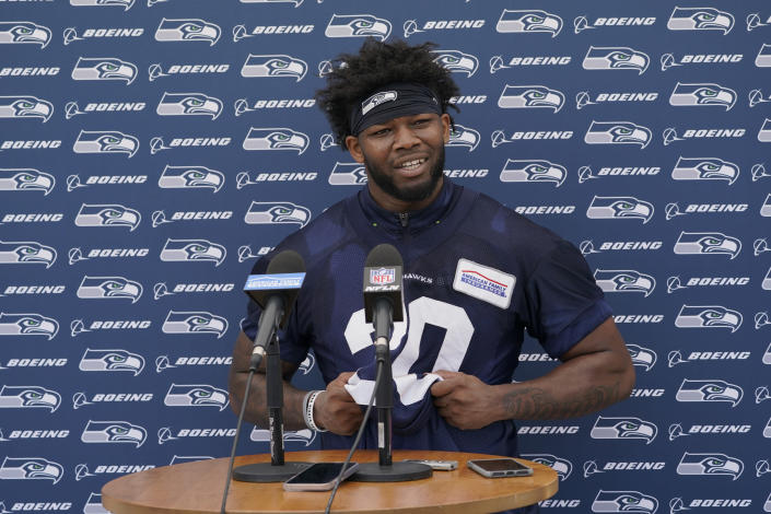 Seattle Seahawks running back Rashaad Penny talks to reporters following NFL football practice Thursday, July 29, 2021, in Renton, Wash. (AP Photo/Ted S. Warren)